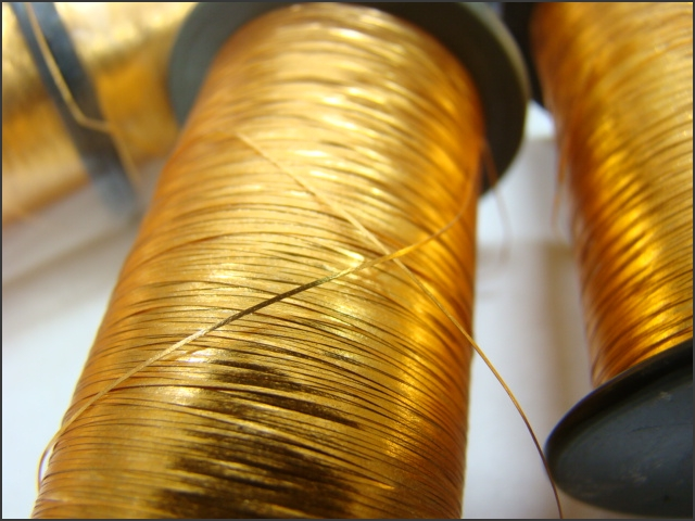 gold flat spool.jpeg